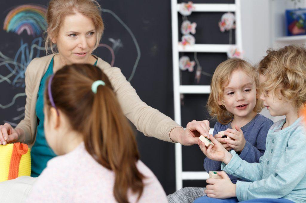 Kindergarten teacher and kids